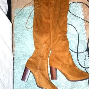 brown thigh high over the knee boots with ties on back
